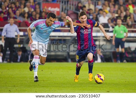 BARCELONA - NOVEMBER 1: Lionel Messi (R) of FCB in action at Spanish League match between FC Barcelona and Celta de Vigo, final score 0-1, on November 1, 2014, in Camp Nou stadium, Barcelona, Spain.