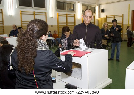 BARCELONA - NOVEMBER 9: Unidentified man votes in symbolic referendum on Catalonia independence, in defiance of the central government in Madrid, on November 9, 2014, in El Masnou, Barcelona, Spain. - stock photo