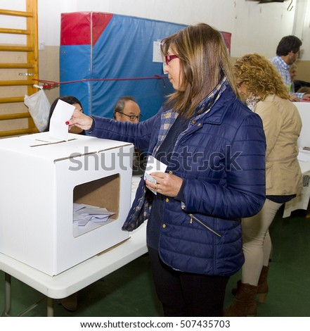 BARCELONA - NOVEMBER 9: Unidentified woman votes in symbolic referendum on Catalonia independence, in defiance of the central government in Madrid, on November 9, 2014, in El Masnou, Barcelona, Spain.