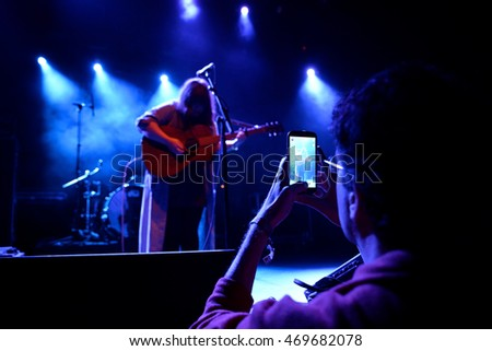 BARCELONA - OCT 24: A man takes a picture with his smartphone  in a concert at Primavera Club 2015 Festival on October 24, 2015 in Barcelona, Spain.