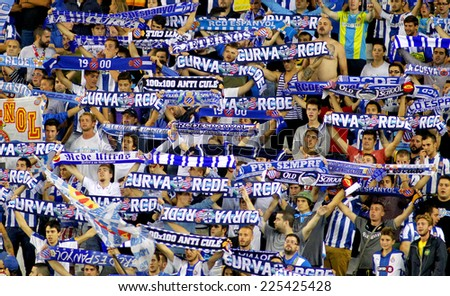 BARCELONA - OCT, 5: Group of supporters of Espanyol during a Spanish League match against Real Sociedad at the Estadi Cornella on October 5, 2014 in Barcelona, Spain - stock photo