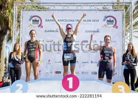 BARCELONA - OCTOBER 5: Anna Godoy wins Garmin Barcelona Triathlon for women, on October 5, 2014, in Barcelona, Spain. Anna Flaquer (L) finished in 2nd place, and Eloise Crowley (R) in 3rd place. - stock photo
