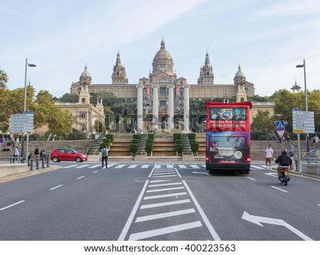 Barcelona - 10 October 2015: Avenue Queen Maria Cristina, tourist bus, and people walk in front of the Museum of Catalonia October 10, 2015 Barcelona,  Catalonia, Spain