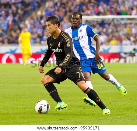 BARCELONA - OCTOBER 2: Cristiano Ronaldo (L) in action during the Spanish League match between Espanyol and Real Madrid, final score 0 - 4, on October 2, 2011 in Cornella stadium, Barcelona, Spain. - stock photo