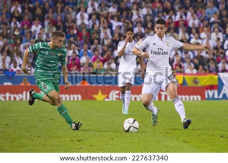 BARCELONA - OCTOBER 29: James Rodriguez of RM (R) in action at the Copa del Rey match between UE Cornella and Real Madrid, final score 1 - 4, on October 29, 2014, in Cornella, Barcelona, Spain. - stock photo
