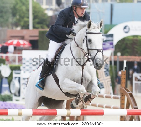 BARCELONA - OCTOBER 10: Jamie Kermond rider in action during the CSIO El Periodico Trophy in Real Club Polo Barcelona, on October 10, 2014, Barcelona, Spain.  - stock photo