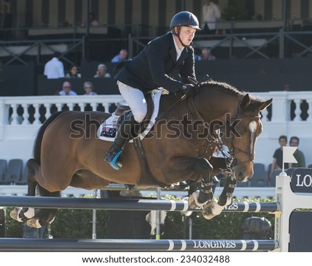 BARCELONA - OCTOBER 09: Jamie Kermond rider in action during the Furusiyya Jumping First Competition in Real Club Polo Barcelona, on October 09, 2014, Barcelona, Spain.  - stock photo