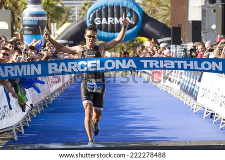 BARCELONA - OCTOBER 5: Javier Gomez Noya, the world champion, wins Garmin Barcelona Triathlon, on October 5, 2014, in Barcelona, Spain. - stock photo