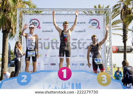 BARCELONA - OCTOBER 5: Javier Gomez Noya wins Garmin Barcelona Triathlon, on October 5, 2014, in Barcelona, Spain. Mario Mola (L) finished in 2nd place, and Francesc Godoy (R) in 3rd place. - stock photo