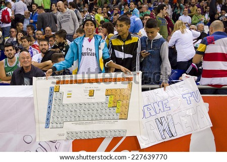BARCELONA - OCTOBER 29: Real Madrid fans with a Periodic Table at the Copa del Rey match between UE Cornella and Real Madrid, final score 1 - 4, on October 29, 2014, in Cornella, Barcelona, Spain. - stock photo