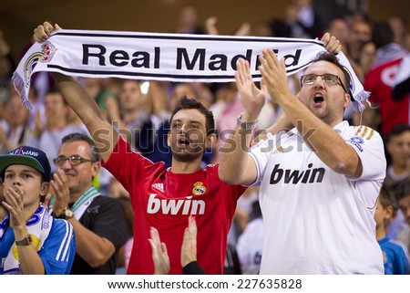 BARCELONA - OCTOBER 29: Real Madrid supporters at the Copa del Rey match between UE Cornella and Real Madrid, final score 1 - 4, on October 29, 2014, in Cornella, Barcelona, Spain. - stock photo