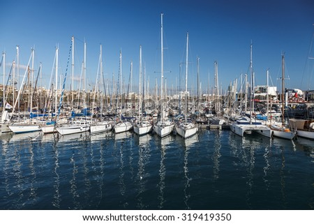 Barcelona port view with many yachts. Port in Barcelona, Spain. - stock photo