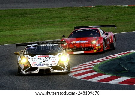 BARCELONA, SAPIN - SEP 7: Team formed by Liam Talbot, Jean-Charles Perrin and Fredy Barth races in a Lamborghini in the 24 Hours of Barcelona, at Catalunya Circuit, on Sep 7, 2014 in Barcelona, Spain - stock photo