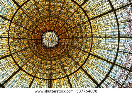 BARCELONA - SEP 22: Palau de la Musica Catalana skylight of stained glass designed by Antoni Rigalt whose centerpiece is an inverted dome in shades of gold, on September 22, 2015 in Barcelona.