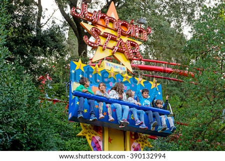 BARCELONA - SEP 5: People have fun at the freefall attraction for kids at Tibidabo Amusement Park on September 5, 2015 in Barcelona, Spain.