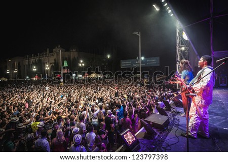 "BARCELONA - SEP 22: Spanish singer Macaco performs at the ""Hard Rock Rocks La Merce"" concert within La Merce celebrations on September 22, 2012 in Barcelona, Spain - stock photo"