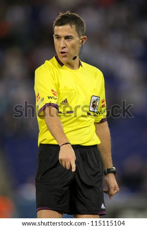 BARCELONA - SEPT 30: Referee Iglesias Villanueva during a Spanish League match between Espanyol and Atletico Madrid at the Estadi Cornella on September 30, 2012 in Barcelona, Spain