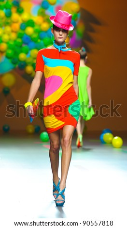 BARCELONA – SEPTEMBER 17: A model walks on the Agatha Ruiz de la Prada catwalk during the Cibeles Madrid Fashion Week runway on September 17, 2011 in Barcelona. - stock photo
