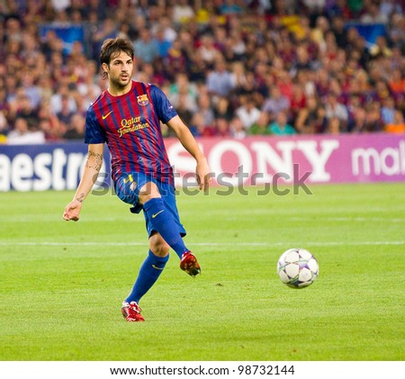 BARCELONA - SEPTEMBER 13: Cesc Fabregas in action during the Champions League match between FC Barcelona and Milan, final score 2 - 2, on September 13, 2011, in Camp Nou stadium, Barcelona, Spain. - stock photo