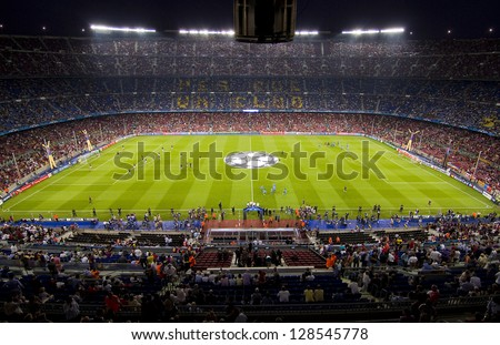 BARCELONA - SEPTEMBER 13: Crowd of people in Camp Nou stadium before the Champions League match between FC Barcelona and AC Milan, final score 2 - 2, on September 13, 2011, in Barcelona, Spain. - stock photo