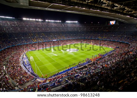 BARCELONA - SEPTEMBER 13: Crowd of people in Camp Nou stadium before the Champions League match between FC Barcelona and AC Milan, final score 2 - 2, on September 13, 2011, in Barcelona, Spain.