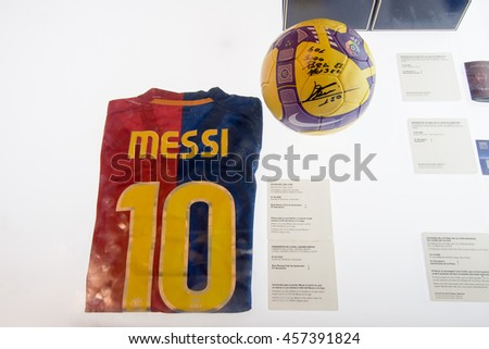 BARCELONA - SEPTEMBER 22, 2014: Football shirt worn by Lionel Messi in the match when he scored Barcelona 5000 League goal. FC Barcelona museum, Camp Nou, Barcelona, Spain. - stock photo