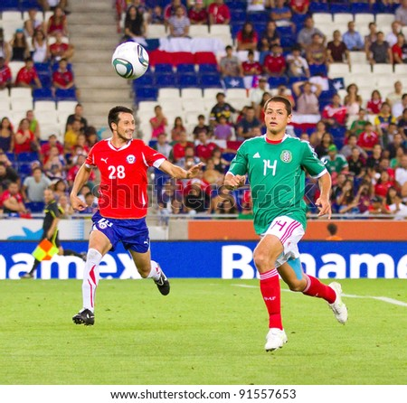 BARCELONA - SEPTEMBER 4: Javier Chicharito Hernandez (14) of Mexico in action during the match between Mexico and Chile, final score 1 - 0, on September 4, 2011, in Cornella stadium, Barcelona, Spain.