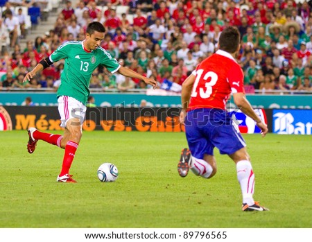 BARCELONA - SEPTEMBER 4: Jesus Zavala of Mexico (L) in action during the friendly match between Mexico and Chile, final score 1 - 0, on September 4, 2011, in Cornella stadium, Barcelona, Spain.