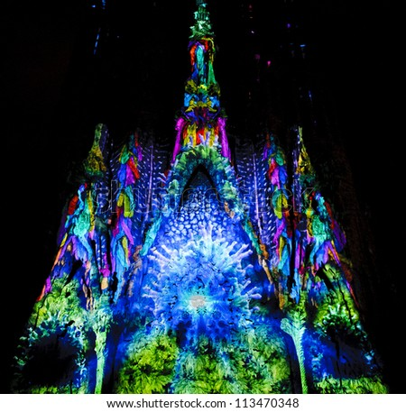 BARCELONA - SEPTEMBER 21: La Sagrada Familia, cathedral designed by Gaudi, with special illumination to commemorate La Merce a traditional Barcelona holiday, on September 21, 2012, Barcelona, Spain. - stock photo
