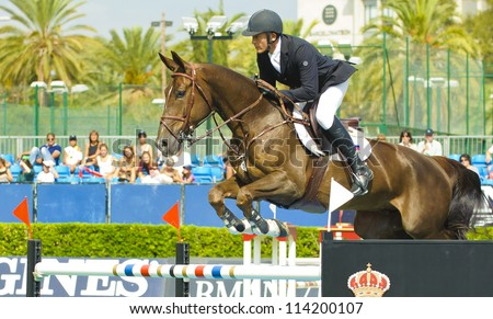 BARCELONA - SEPTEMBER 22: Vladimir Tugonov rider in action during the CSIO 101th International jumping competition in Real Club Polo Barcelona, on September 22, 2012, Barcelona, Spain.