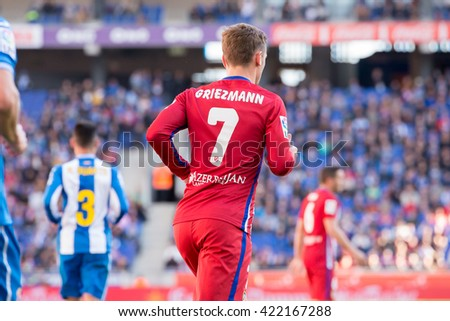 BARCELONA, SPAIN - APR 9: Antoine Griezmann plays at the La Liga match between RCD Espanyol and Atletico de Madrid at the Powerade Stadium on April 9, 2016 in Barcelona, Spain. - stock photo