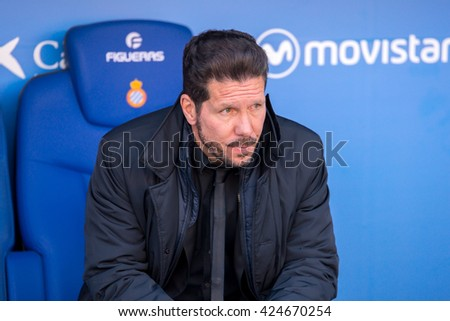 BARCELONA, SPAIN - APR 9: Diego Pablo El Cholo Simeone sits on the bench at the La Liga match between RCD Espanyol and Atletico de Madrid at the Powerade Stadium on April 9, 2016 in Barcelona, Spain. - stock photo