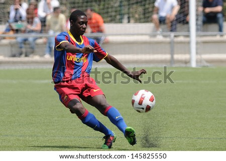 BARCELONA, SPAIN - APR 30: Moustapha Seck (Mousta) plays with F.C Barcelona youth team against Mercantil on April 30, 2011 in Barcelona, Spain. - stock photo