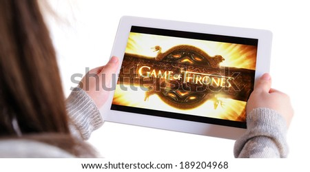 BARCELONA, SPAIN - APR 18, 2014: Unrecognizable woman watching, on her Apple Ipad, Game of Thrones, a famous American fantasy drama television series created for HBO, isolated on white background. - stock photo