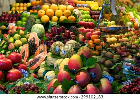 BARCELONA, SPAIN - APRIL 23, 2014: Assortment of different fruits on the stalls of a street market