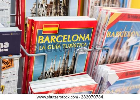 BARCELONA, SPAIN - APRIL, 2015: Barcelona guidebooks offered at market stall on La Rambla - stock photo