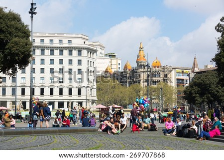 BARCELONA, SPAIN - APRIL  5, 2015:  Catalonia Square in spring day. Barcelona, Catalonia.  Some of most important streets and avenues meet at here. Center of business and cultural life