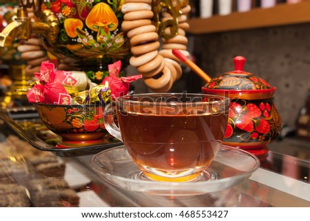Barcelona,Spain- April 2016: Cup of hot tea in transparent glass prepared with russian traditional kettle Samovar in Russian cuisine restaurant.