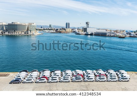 Barcelona, Spain - April 19, 2016: New cars ready for shipment at the port of Barcelona, Catalonia, Spain