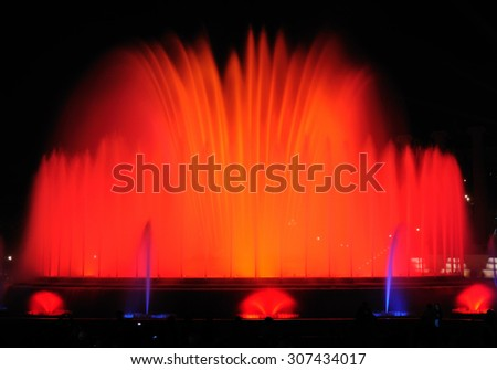 BARCELONA, SPAIN - APRIL 25, 2015: Night show of singing fountains - spectacular display of color, light, music and water motion. The most popular tourist attraction of the city.