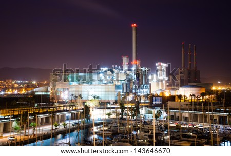 BARCELONA, SPAIN - APRIL 9: night view of Endesa power plant and Port Forum in April 9, 2013 in Barcelona, Spain. Combined cycle power plant of Endesa in Sant Adria del Besos - stock photo