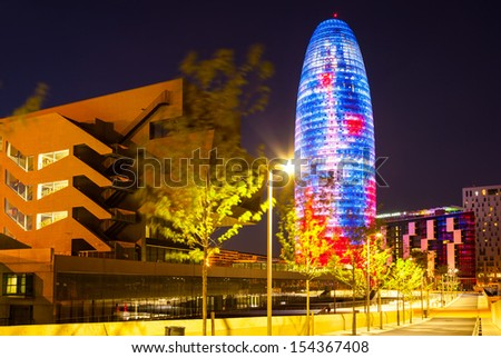BARCELONA, SPAIN - APRIL 12: Night view of Torre agbar in April 12, 2013 in Barcelona, Spain. 38 storey skyscraper, built in 2005 by Jean Nouvel. Now one of the symbols of city is owned by Grupo Agbar