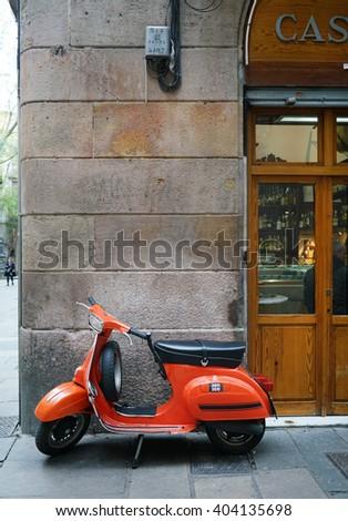 Barcelona, Spain - April 04, 2016:Old Vespa parked on old street in Barcelona,Spain - stock photo
