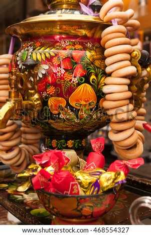 Barcelona, Spain - April 5, 2016: Painting traditional Russian samovar with bunch of crackers bagels in Russian cuisine restaurant