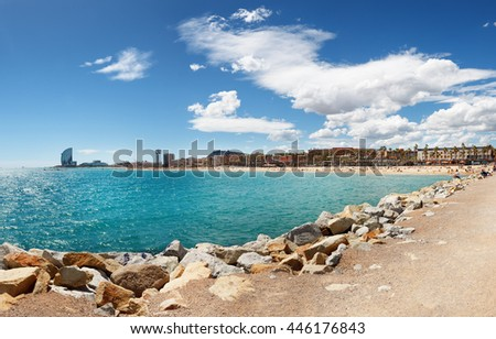 Barcelona, Spain - April 17, 2016: panoramic view on Barceloneta with modern architecture buildings sand beach on sunny day.