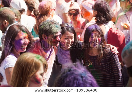 BARCELONA, SPAIN - APRIL 6, 2014: People at Festival of colors Holi Barcelona. Holi is  holiday of Indian Culture