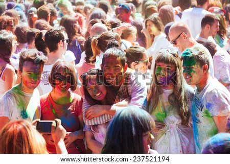 BARCELONA, SPAIN - APRIL 6, 2014: People at IV Festival de los colores Holi Barcelona. Holi is traditional holiday of Indian Culture