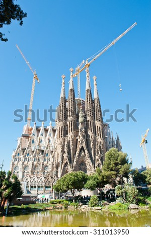 BARCELONA, SPAIN - APRIL 28, 2015: Sagrada Familia is a Roman Catholic church in Barcelona, designed by Catalan architect Antoni Gaudi. Is not finished yet  - stock photo