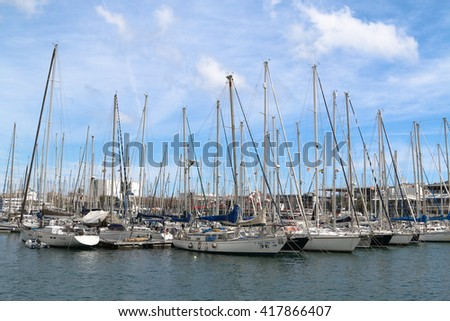 BARCELONA, SPAIN - April 1, 2016: Yachts and sailboats in Port Vell marina in Barcelona, Catalonia, Spain. This port one of the old ports of Barcelona.