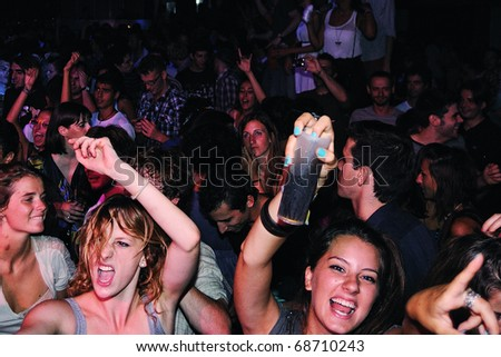 BARCELONA, SPAIN - AUG 20: Fans of Mendetz band, concert at Discotheque Razzmatazz on August 20, 2010 in Barcelona, Spain. - stock photo